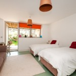 Twin Bedroom on ground floor opening onto the lower chill out zone